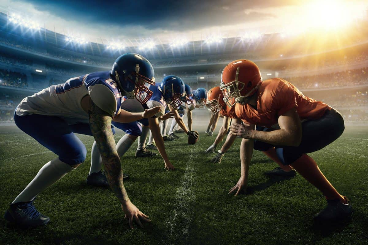American football teams stay head to head on a generic outdoor football stadium under a cloudy sky with bright sun, How Many Positions Can You Play In Football?