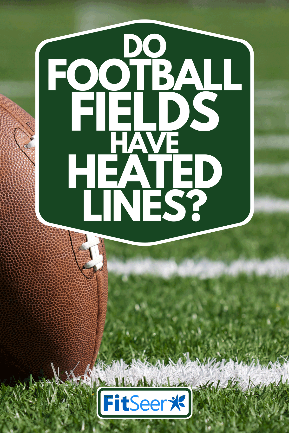 A football on white yard lines of football turf, Do Football Fields Have Heated Lines?