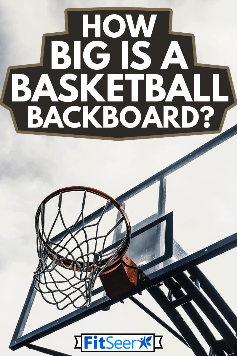 Silhouette of basketball hoop with nice sky background, How Big Is A Basketball Backboard?