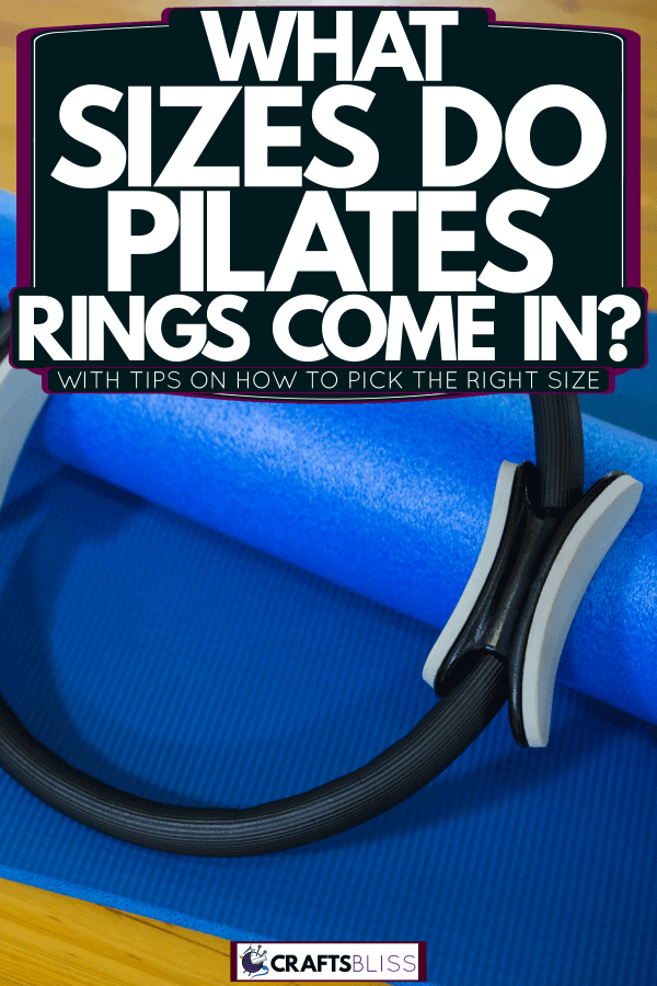 A black pilates ring on a blue pilates mat, What Sizes Do Pilates Rings Come In? [With Tips On How To Pick The Right Size]